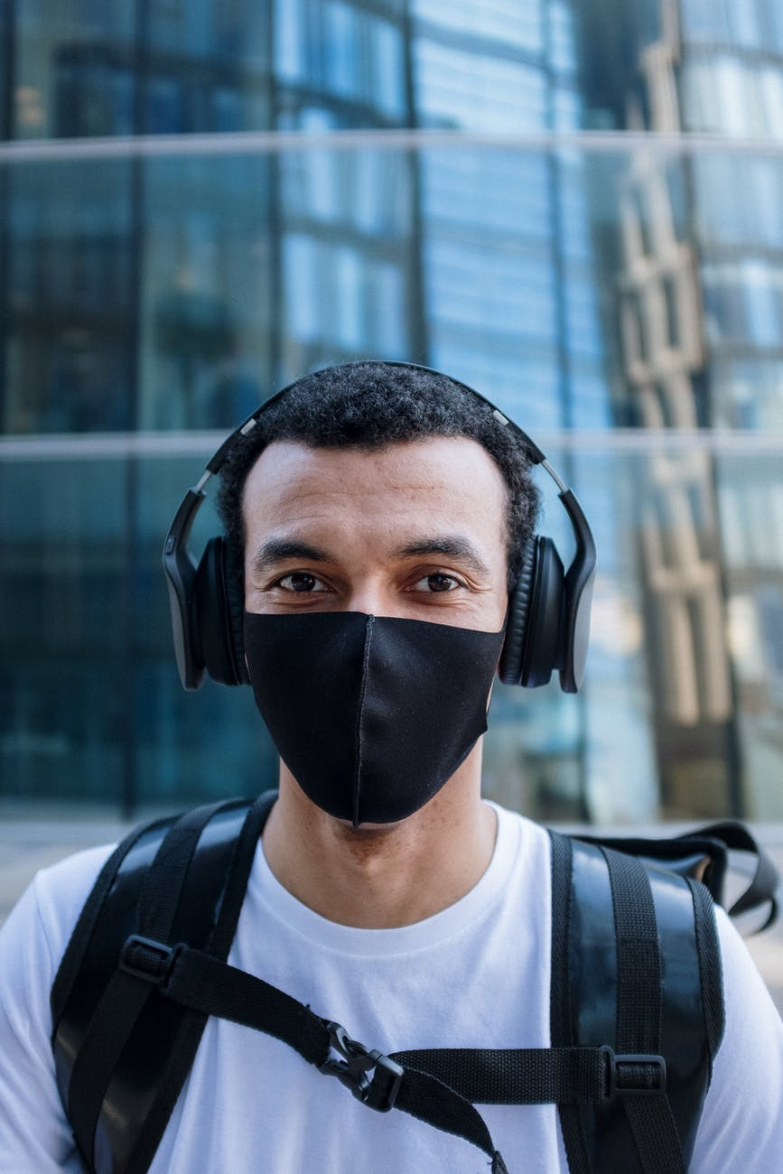 man in black face mask